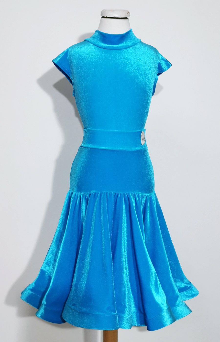 Juvenile turquoise velvet dress